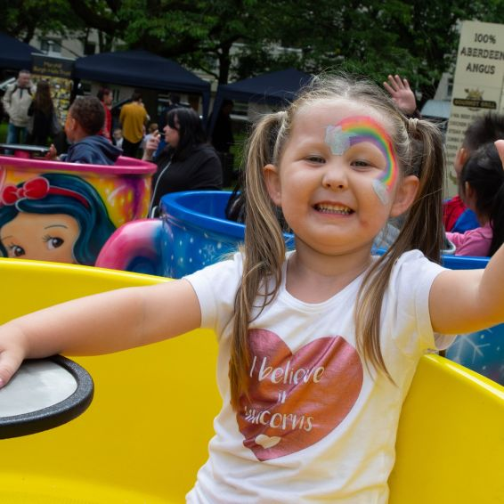 Lucy has fun on the Wyndford tea cup ride
