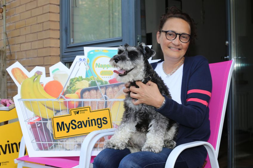 Pauline Gilmore and her pet pooch Reggie are loving MySavings